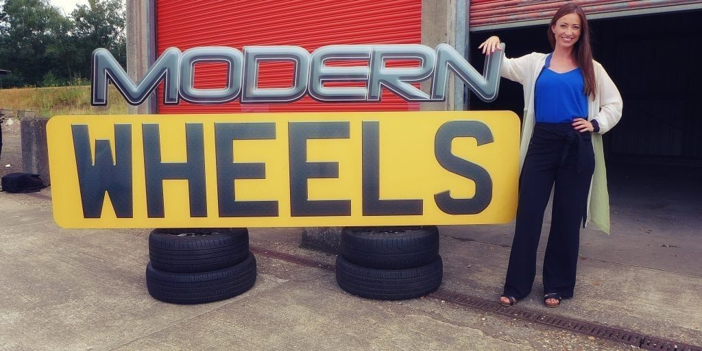 Modern Wheels or Classic Steals Generics Picture Shows: Rebecca in front of Classic Steals sign